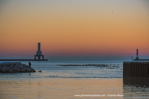 Lighthouse and fisherman